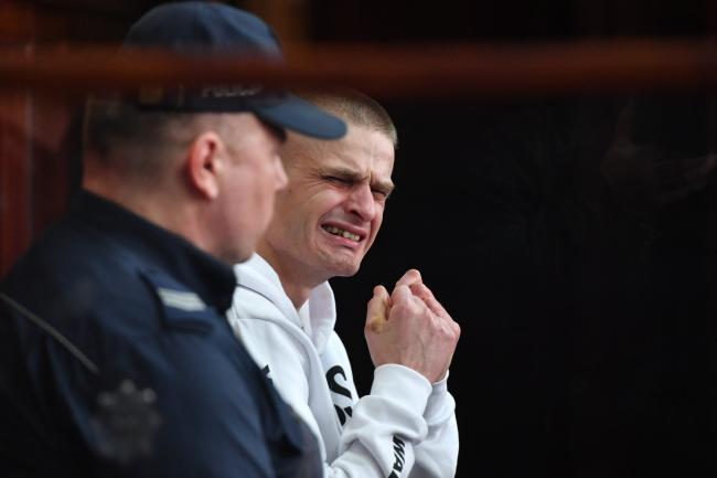Томаш Коменда во время оглашения решения об освобождении.