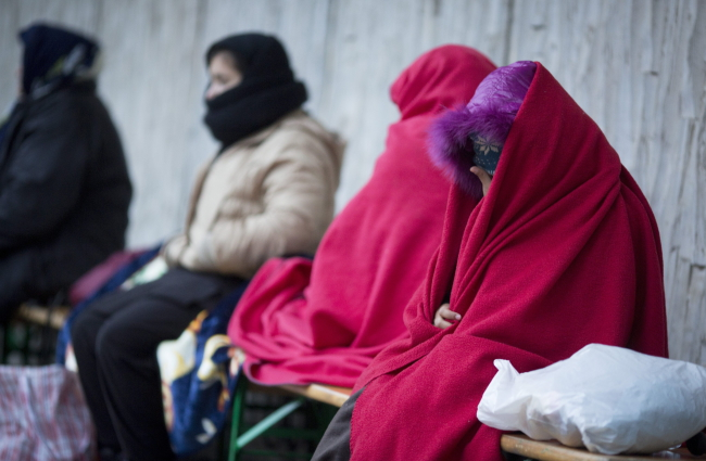 Refugees wait in cold temperatures for registration and the allocation of sleeping places at the State Office for Health and Social Affairs (LaGeSo) in Berlin, Germany. Photo: EPA/KAY NIETFELD
