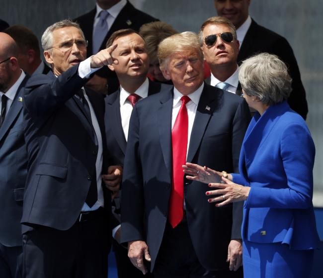 Зліва направо: очільник НАТО Єнс Столтенберґ, президент Польщі Анджей Дуда, президент США Дональд Трамп, прем'єр-міністр Великої Британії Тереза Мей
