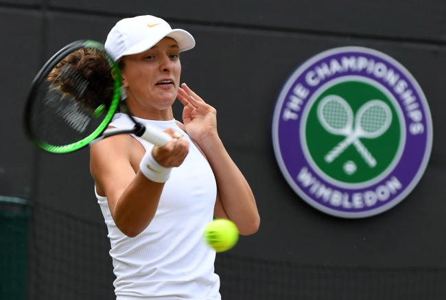 Poland's Iga Swiątek in action against Leonie Kung of Switzerland during their Girls Singles Final at the Wimbledon Championships in London on Saturday. Photo: EPA/GERRY PENNY