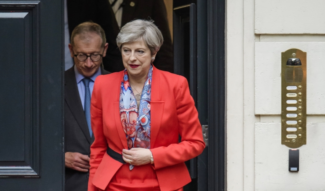 Theresa May fighting to hang on after election gamble fails