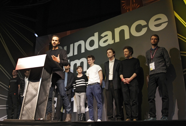 Director Michał Marczak (L) accepts the 'Directing Award: World Cinema Documentary' for the film 'All These Sleepless Nights' at the 2016 Sundance Film Festival awards ceremony in Park City, Utah, USA, 30 January 2016. Photo: EPA/GEORGE FREY