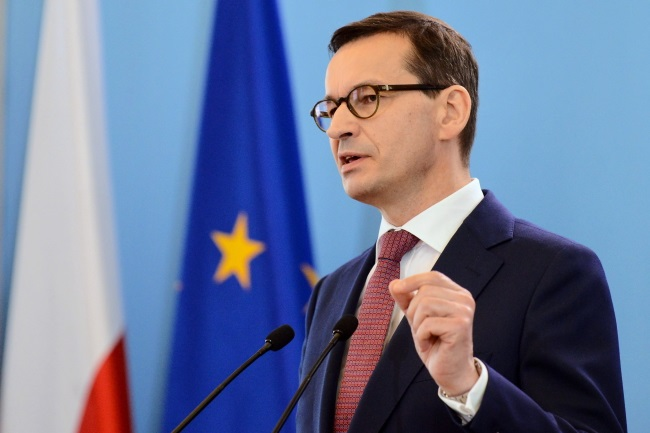 Poland's Prime Minister Mateusz Morawiecki gives a press conference after a meeting of his Cabinet in Warsaw on Tuesday. Photo: PAP/Jakub Kamiński