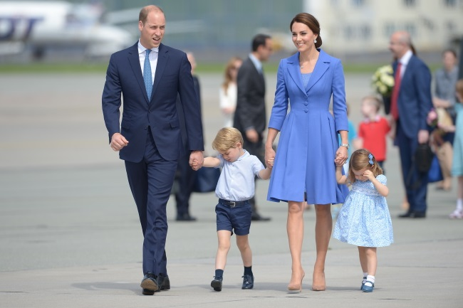 Britain's Prince William, his wife Kate and their children George and Charlotte leaving  Poland. Photo: PAP/Marcin Obara