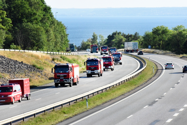 A convoy of Polish fire vehicles in Sweden, pictured last week. Photo: EPA/Anna Hallams