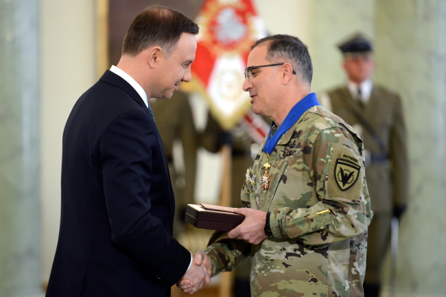 Polish President Andrzej Duda awards NATO's Supreme Allied Commander Europe, general Curtis Scaparrotti, the Commander's Cross with Star of the Order of Merit of the Republic of Poland. Photo: PAP/Jakub Kamiński.
