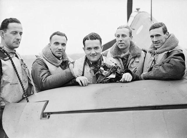 "Pilot Officer Mirosław Ferić, Flying Officers Bogdan Grzeszczak, Jan Zumbach and Zdzisław Henneberg and Flight-Lieutenant J. A. Kent, who commanded ""A"" Flight of No. 303 (Polish) Squadron RAF, October 1940. Photo: Wikimedia Commons"