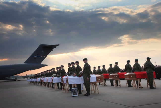 Archive picture from April 15, 2010 taken at Warsaw's military airport, showing coffins with the bodies of some of the victims of the Smolensk disaster. Photo: PAP / Paweł Supernak