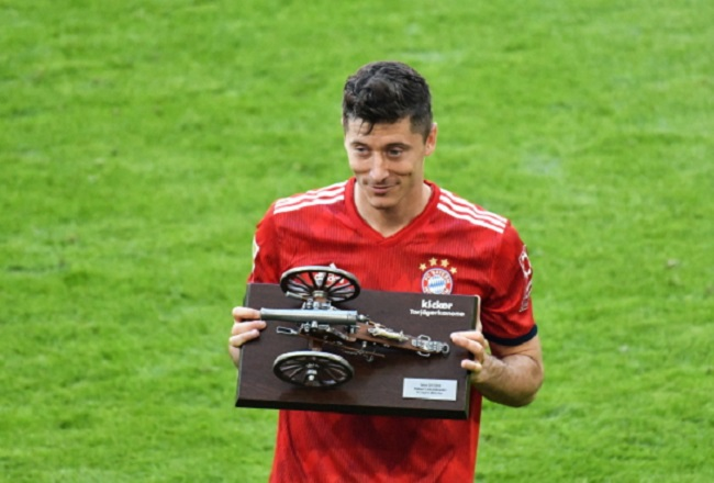 Robert Lewandowski poses with the trophy for the German Bundesliga's top scorer after a match between Bayern Munich and VfB Stuttgart in Munich on Saturday. Photo: EPA/PHILIPP GUELLAND