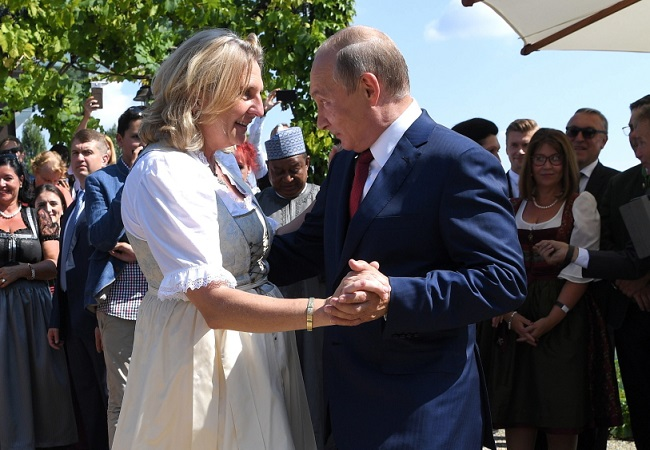 Austrian Foreign Minister Karin Kneissl dances with Russian President Vladimir Putin during her wedding in Gamlitz, Austria, in August. Photo: EPA/ROLAND SCHLAGER