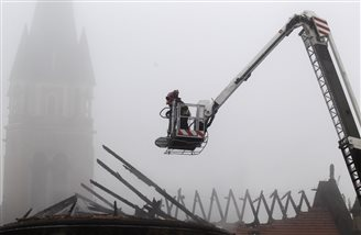 Government calls for aid after fire ravages cathedral