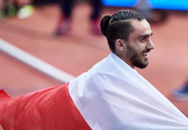 Adam Kszczot celebrates 800 metre win in Belgrade. Photo: PAP/Adam Warżawa.