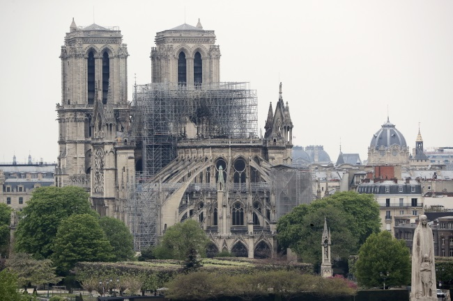 The damaged Notre Dame Cathedral after a massive fire that destroyed its roof.  Photo: EPA/CHRISTOPHE PETIT TESSON