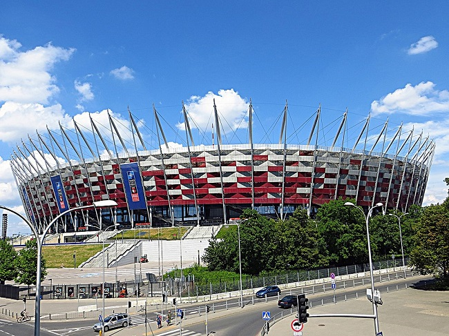 The National Stadium in Warsaw. Photo: Mister No [CC BY 3.0 (https://creativecommons.org/licenses/by/3.0)], via Wikimedia Commons