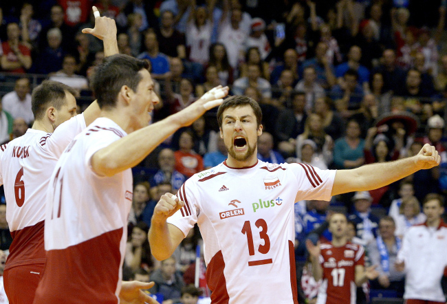 Polish players Bartosz Kurek, Rafał Buszek and Michał Kubiak during the match against Germany. Photo: PAP/Darek Delmanowicz