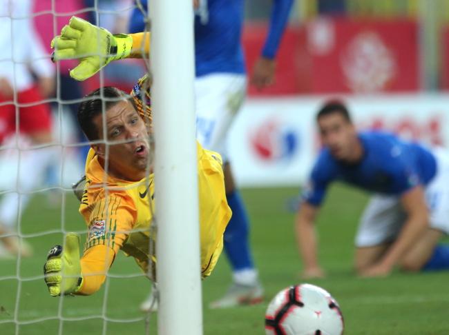 Poland goalie Wojciech Szczęsny lunges but fails to stop Italy scoring. Photo: PAP/Andrzej Grygiel