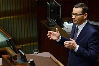 Polish PM wins vote of confidence in parliament