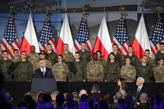 Polish President Andrzej Duda (left), US Vice President Michael Pence (right) and Second Lady Karen Pence (second from right) at the signing ceremony during a meeting with Polish and American soldiers at the 1st Transport Air Base in Warsaw on Wednesday. Photo: PAP/Radek Pietruszka