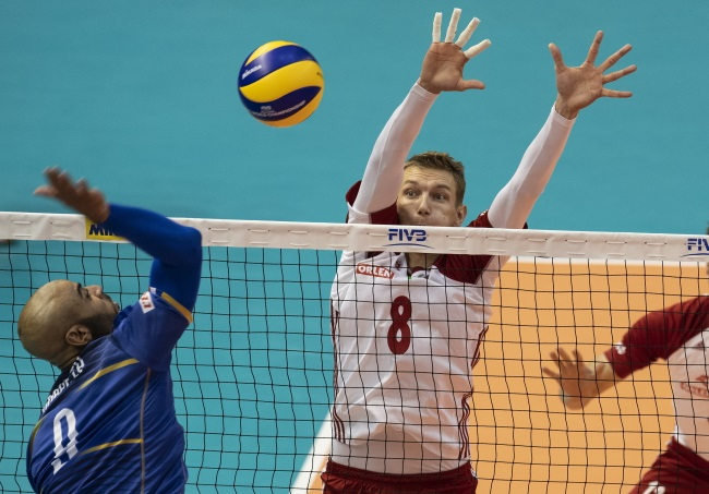 Poland's Damian Schulz (right) in action against France. Photo: EPA/VASSIL DONEV