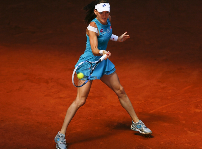 Poland's Agnieszka Radwanska returns the ball to Denmark's Caroline Wozniacki during their third round match at the Mutua Madrid Open tennis tournament in Madrid, Spain, 06 May 2015. EPA/JUANJO MARTIN