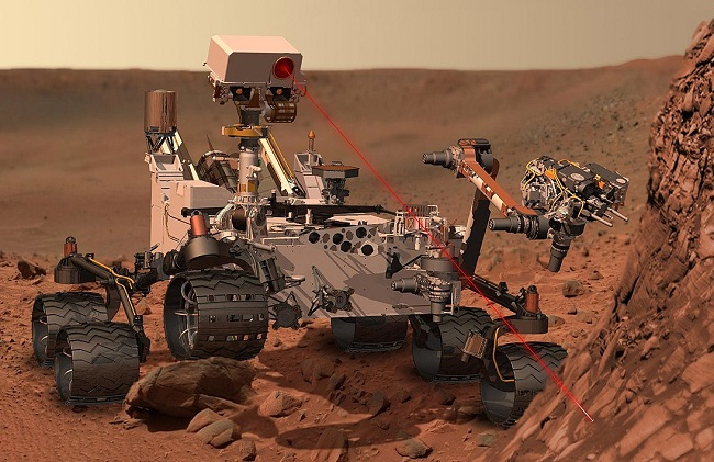 An artists conception of a Mars rover vaporising rock. Photo: NASA/JPL-Caltech/Wikimedia Commons (Public Domain)