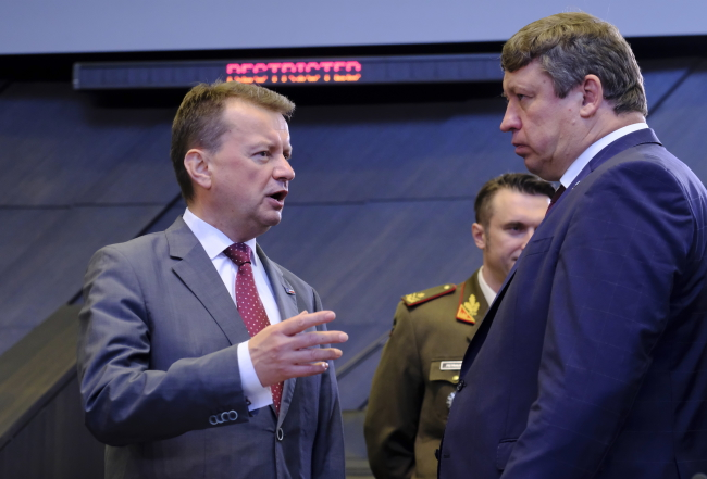 Polish Defence Minister Mariusz Błaszczak and his Lithuanian counterpart Raimundas Karoblis at the start of a North Atlantic council gathering during a NATO defence ministers' meeting in Brussels