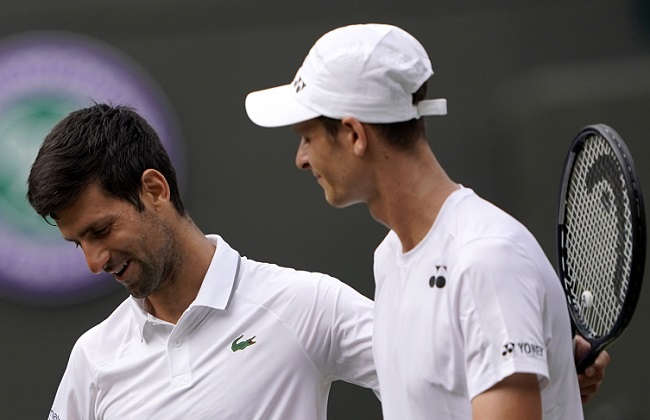 Novak Djokovic (left) celebrates winning against Hubert Hurkacz (right) during their third-round match at the Wimbledon tennis championships on Friday.