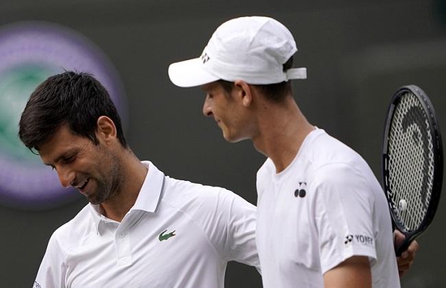 Novak Djokovic (left) celebrates winning against Hubert Hurkacz (right) during their third-round match at the Wimbledon tennis championships on Friday.