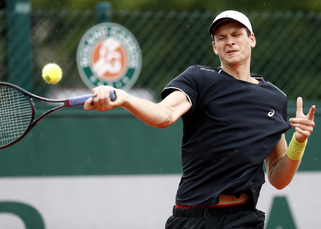 Hubert Hurkacz in action against Tennys Sandgren at the French Open. Photo: EPA/IAN LANGSDON