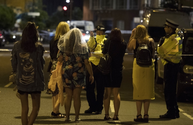 Police officers following reports of an incident involving a van hitting pedestrians on London Bridge and stabbings and shootings in Borough Market, Central London. Photo: EPA/WILL OLIVER