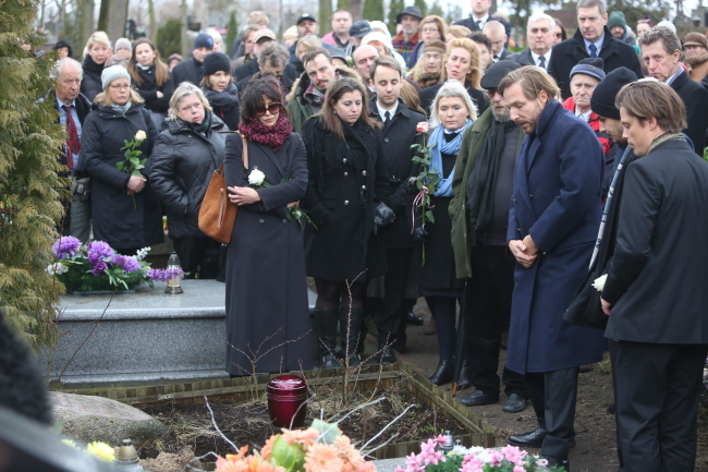 The funeral of Polish director Andrzej Żuławski. Mourners included son Xawery (3R) and former partner Sophie Marceau (C). Photo: PAP/Leszek Szymański