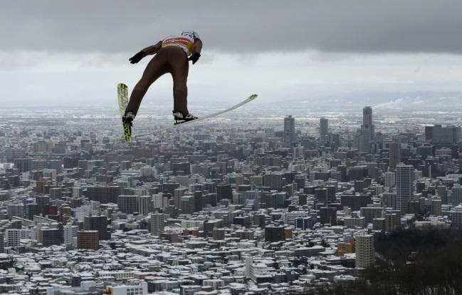 Kamil Stoch in action in Sapporo, Japan, 12 February. Photo: EPA/KIMIMASA MAYAMA