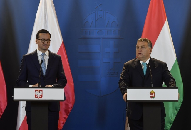 Polish Prime Minister Mateusz Morawiecki and his Hungarian counterpart Viktor Orban give a joint press conference following their talks in Budapest on Wednesday. Photo: EPA/Tibor Illyes