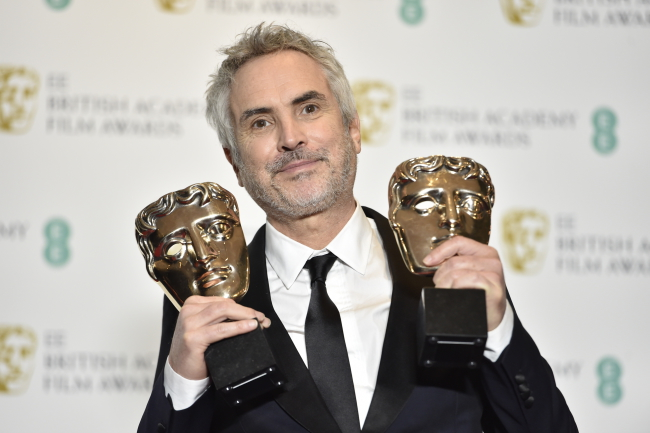 Alfonso Cuaron poses with his awards for Best Film and Best Director at the British Academy Film Awards at the Royal Albert Hall in London. Photo: EPA/NIK HALLEN