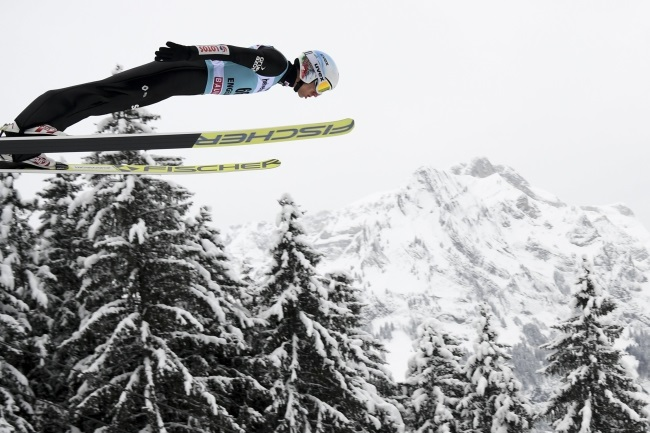 Poland's Kamil Stoch is airborne during the men's HS 140 competition at the FIS Ski Jumping World Cup in Engelberg, Switzerland, on Sunday. Photo: EPA/GIAN EHRENZELLER