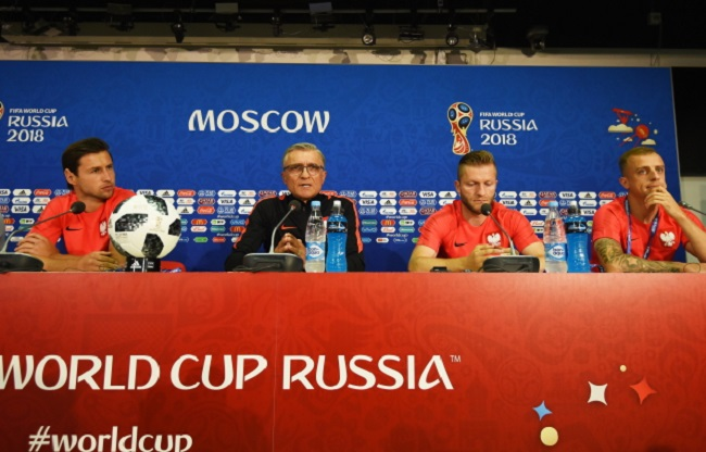 Poland manager Adam Nawalka (2nd from left) and players (left to right) Grzegorz Krychowiak, Jakub Błaszczykowski, and Kamil Grosicki attend a press conference in Moscow on Monday. Photo: EPA/FACUNDO ARRIZABALAGA