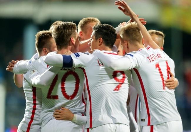 Poland celebrates its winning goal. Photo: EPA/Koca Sulejmanovic.
