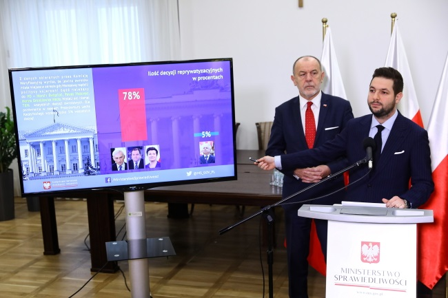 Patryk Jaki (right), head of the special parliamentary commission, and member Jan Mosiński (left) during a news conference in Warsaw on Monday. PAP/Rafał Guz