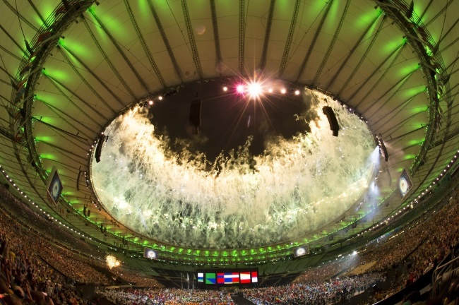 Spectators watch fireworks during the closing ceremony of the Rio 2016 Paralympic Games at the Maracana Stadium in Rio de Janeiro, Brazil. Photo: EPA/SZILARD KOSZTICSAK