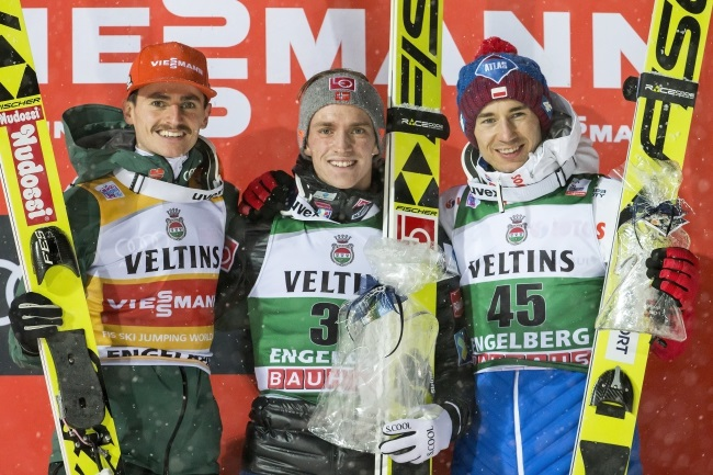 Second-placed Richard Freitag of Germany, winner Anders Fannemel of Norway, and third-placed Kamil Stoch of Poland, celebrate on the podium for the men's HS 140 competition at the FIS Ski Jumping World Cup in Engelberg, Switzerland, on Saturday. Photo: EPA/ALEXANDRA WEY