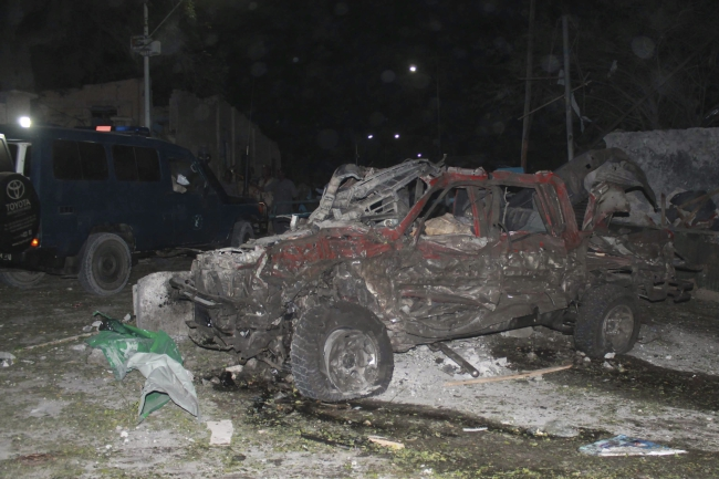 A damaged vehicle is seen at the scene of a car bomb explosion in Mogadishu, Somalia, 21 September 2015. EPA/SAID YUSUF WARSAME