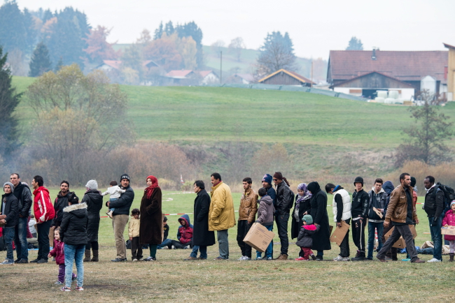 Refugees in field on their way to Germany near Hanging at the German-Austrian border in Hanging, Austria, 04 November 2015. EPA/ARMIN WEIGEL