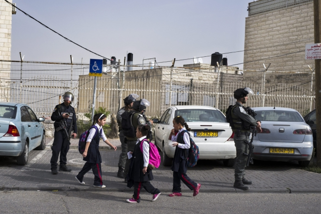 Israeli Border Police on patrol as Palestinian children return home as school is let out in the Mount of Olives area of Arab East Jerusalem, 03 November 2015. Israel continues increased security throughout Jerusalem. EPA/JIM HOLLANDE