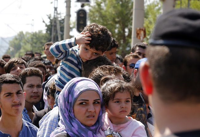 Migrants at the Greek–Macedonian border. Photo: Wikimedia Commons/Dragan Tatic/Austrian Foreign Ministry.