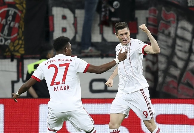 Robert Lewandowski (right) celebrates after scoring the 2-0 lead during the German Cup semifinal match between his Bayern Munich and Bayer Leverkusen on Tuesday. EPA/FRIEDEMANN VOGEL