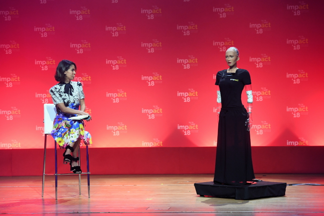 Humanoid robot Sophia (right) addresses the Impact'18 conference. Photo: PAP/Jacek Bednarczyk.