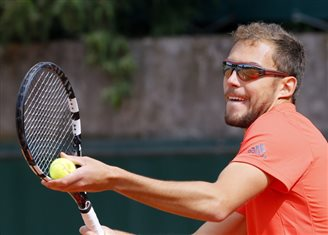 Janowicz drops out of Roland Garros