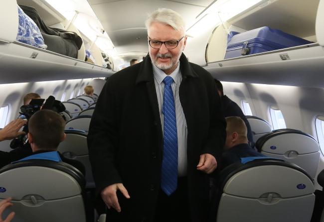 Polish Foreign Minister Witold Waszczykowski on board his flight to Ireland. Photo: PAP/Paweł Supernak.