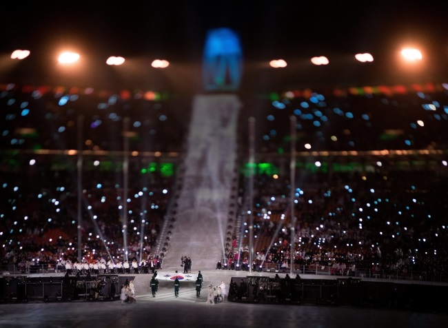 Flag bearers enter with the South Korean flag during the opening ceremony of the XII Paralympic Winter Games in the Pyeongchang Olympic Stadium. Photo: EPA/SIMON BRUTY/OIS/IOC