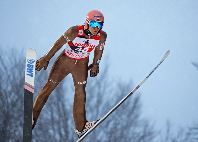 Poland's Dawid Kubacki in action during a trial round of the FIS Ski Jumping World Cup in Willingen, Germany. Photo: EPA/RONALD WITTEK Dostawca: PAP/EPA.